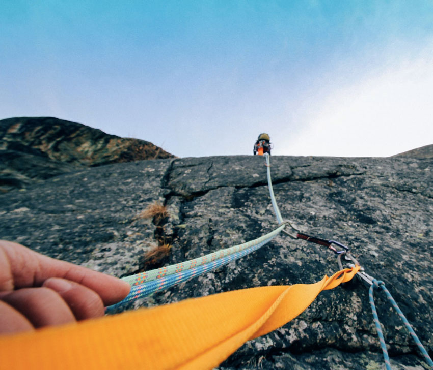 management consulting poster showing a man climbing a mountain